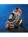 Inel vintage masiv, model oval si inalt, cu cristal albastru si doua cristale rosii