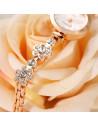 Ceas auriu tip bratara cu flori din cristale si cadran rotund simplu