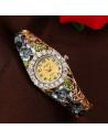 Ceas de mana, tip bratara, ornat cu flori si cristale, frunzulite verzi
