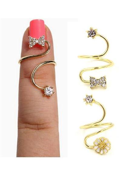 Inel pentru unghie auriu cu papion si steluta din cristale mici