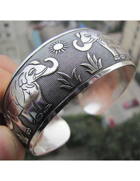 Bratara vintage metalica argintie forma convexa cu elefanti