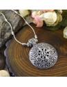 Lant argintiu cu medalion floral tibetan si pietre din howlit turcoaz